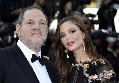 epa04762672 US producer Harvey Weinstein (L) and his wife Georgina Chapman (R) arrive for the screening of 'The Little Prince' during the 68th annual Cannes Film Festival, in Cannes, France, 22 May 2015. The movie is presented out of competition at the festival which runs from 13 to 24 May.  EPA/FRANCK ROBICHON